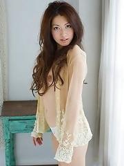 Japan girl Hikaru Takizawa undresses to show her sexy body and hairy pussy