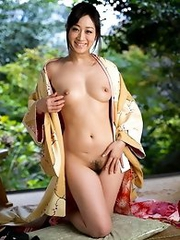 Beautiful and elegant Japanese av idol Yu Kawakami strips her kimono to show her naked body