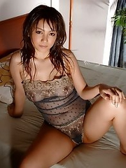 Busty and sweet Japanese av idol Meguru Kosaka shows her sexy busty tits