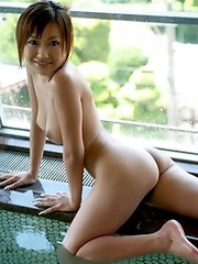 Sexy japanese Nana Konishi in white lingerie and hairy pussy