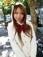Remika Uehara poses on the street