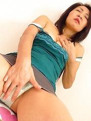 Horny Asian MILF teasing herself