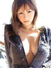 Anri Sugihara shows big boobs in smiling boobs on the beach