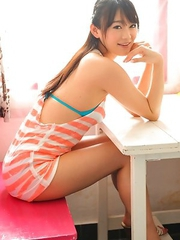Shou Nishino in blue bath suit sits with ass up in the air