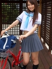 Misaki Nito in school uniform goes to classes riding bike