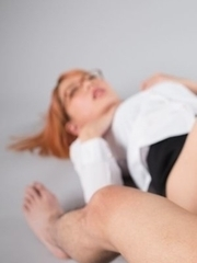 Nerdy redhead with glasses Chie Kobayashi giving a great footjob in a POV gallery