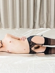 Stockings-clad bombshell Rio Kamimoto jerks his cock with her perfect toes
