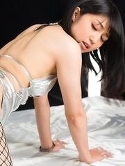 Fishnets-wearing JAV performer Reo Saionji giving a very passionate assjob