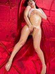Ruru Sakurai wearing pink stockings and showing off her ass on camera